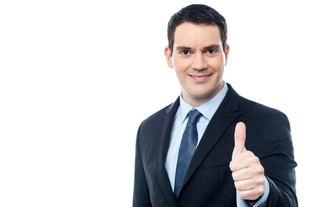 Middle aged businessman showing thumbs up gesture Standard-Bild