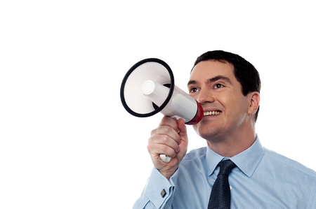 making an announcement: Male executive making announcement over a megaphone