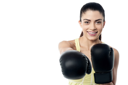 pugilist: Fit woman ready to fight with boxing gloves