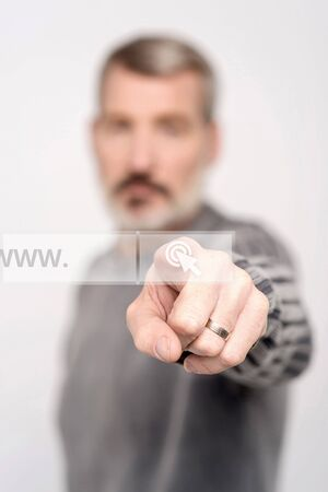 search bar: Man touching search bar on virtual screen Stock Photo