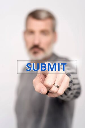 submit button: Man pressing submit button on digital interface Stock Photo