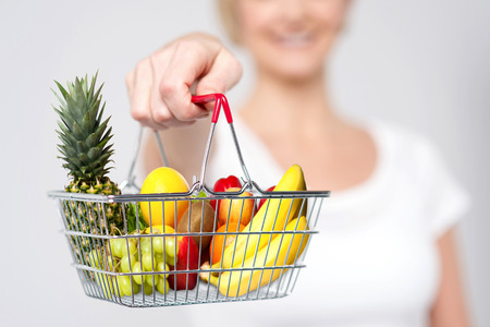 woman shopping cart: Cropped image of woman showing shopping cart