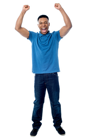 clenching: Full length of successful young man clenching his fists Stock Photo