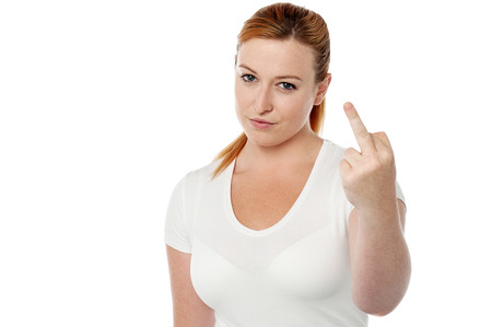 freaking: Young woman making fuck you gesture