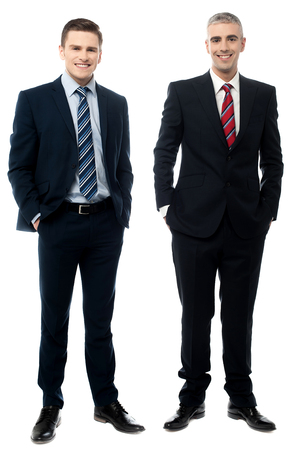 full length: Full length of businessmen posing together Stock Photo