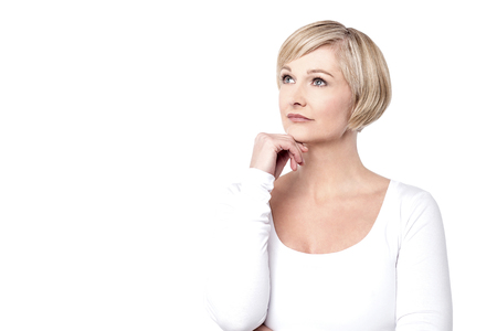 skeptic: Thoughtful woman with her hand on chin