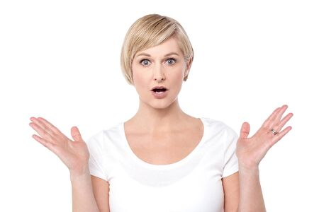 wide open: Shocked woman with her arms wide open Stock Photo
