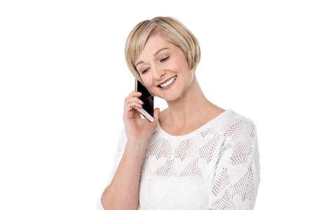 beautiful middle aged woman: Beautiful middle aged woman talking on cell phone Stock Photo