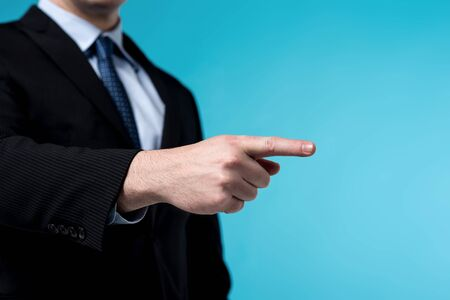 cropped: Cropped image of businessman pointing his finger