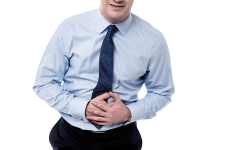 Cropped image of businessman suffering from stomach pain