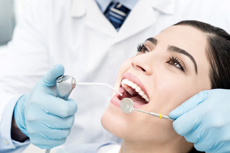Young female patient whitening her teeth Stock Photo - 39290717