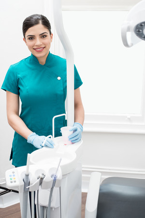 Female assistant posing in modern dental clinic Stock Photo