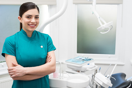 Confident female dental assistant posing