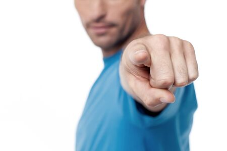 cropped: Casual man pointing to camera, cropped image. Stock Photo