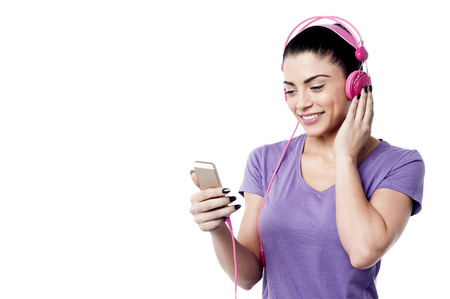 copy sapce: Happy woman listening music from her cell phone