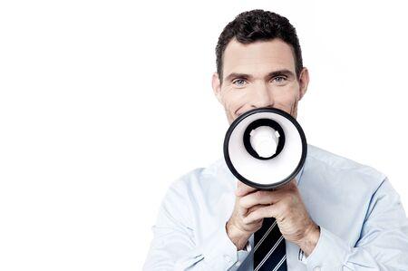 loudhailer: Hombre anuncio decisiones ejecutivas con loudhailer Foto de archivo