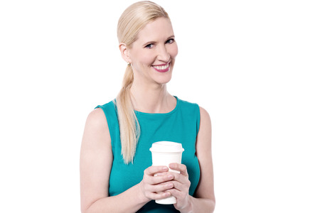 disposable cup: Smiling woman posing with disposable cup Stock Photo