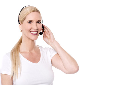 ear phones: Happy female call center staff with ear phones