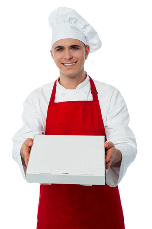 pizza box: A chef in red uniform offering you a pizza box