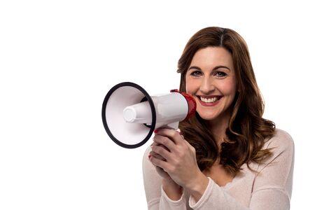 loudhailer: Cheerful woman posing with loudhailer
