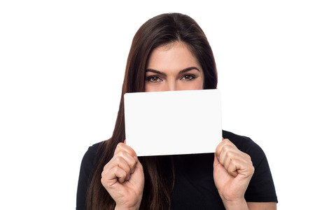 advertise with us: Young woman showing blank banner to camera