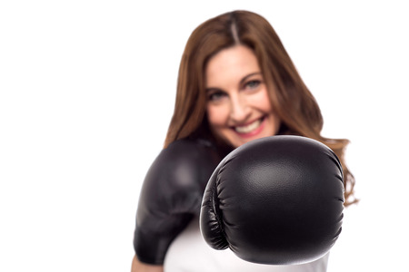pugilist: Young woman with boxing gloves, focus on gloves