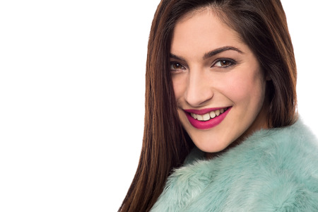 fur coat: Sideways of trendy woman in luxurious fur coat Stock Photo