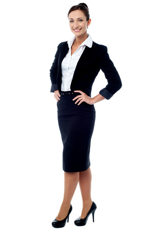 Full length of businesswoman posing casually Stock Photo