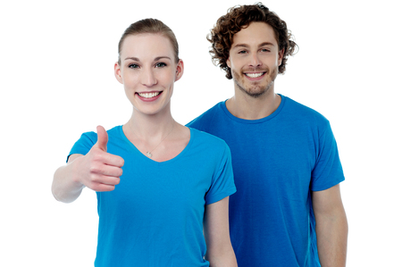 posing  agree: Happy woman gesturing thumbs up to camera Stock Photo