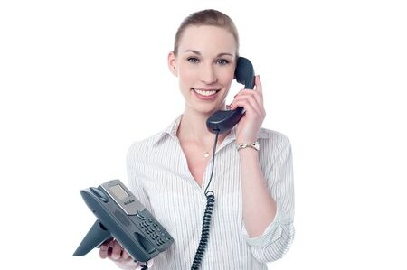 answering: Happy female executive answering a phone call