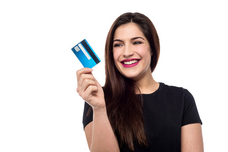 smiling young woman holding credit card stock photo picture and