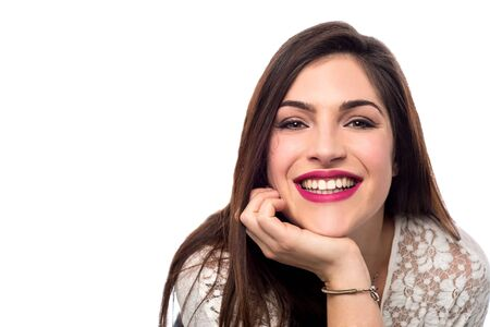 chin: Happy smiling woman hands on her chin Stock Photo