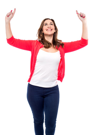 celebrating female: Happy woman celebrating with her arms raised