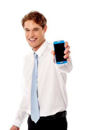 side pose: Side pose of salesman showing new launched mobile