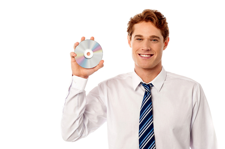 cdrom: Young sales executive showing a new cd-rom