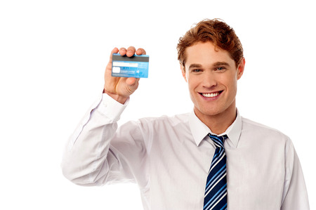 Smiling male executive showing new credit card photo
