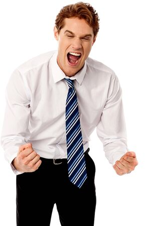 clenching: Excited corporate male clenching his fists