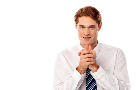 clasped: Smart young male executive with hands clasped Stock Photo