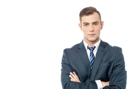 folded arms: Young handsome businessman with folded arms. Stock Photo