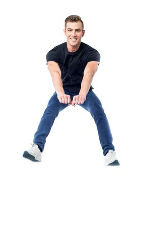cool guy: Young handsome cool guy jumping high Stock Photo