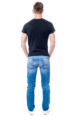 back view of man: Full length image of man facing the wall