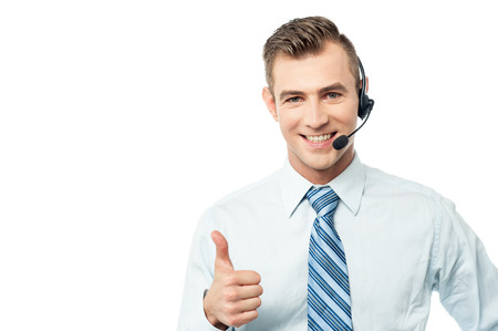 Customer support executive showing thumbs up Stockfoto