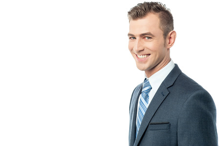 side pose: Side pose of cheerful businessman over white