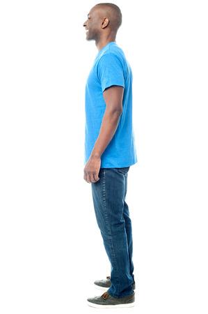 Full length of casual man posing sideways
