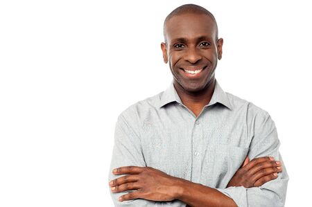 middle aged man: Smiling middle aged man with crossed arms Stock Photo