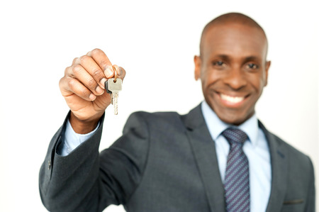 Happy smiling engineer showing the house key photo