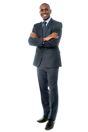 folded arms: Image of a successful businessman with folded arms