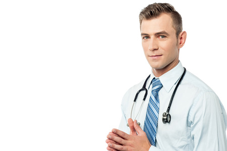 clasped: Successful male doctor with his hands clasped Stock Photo