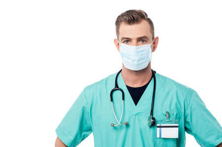 surgical mask: Male doctor posing with surgical mask Stock Photo
