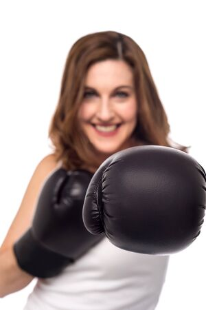 pugilist: Woman with boxing gloves, focus on gloves
